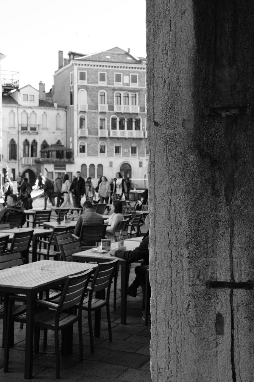 building exterior, built structure, architecture, real people, table, outdoor cafe, cafe, outdoors, day, sidewalk cafe, women, leisure activity, chair, large group of people, lifestyles, men, city, sky, nature, people