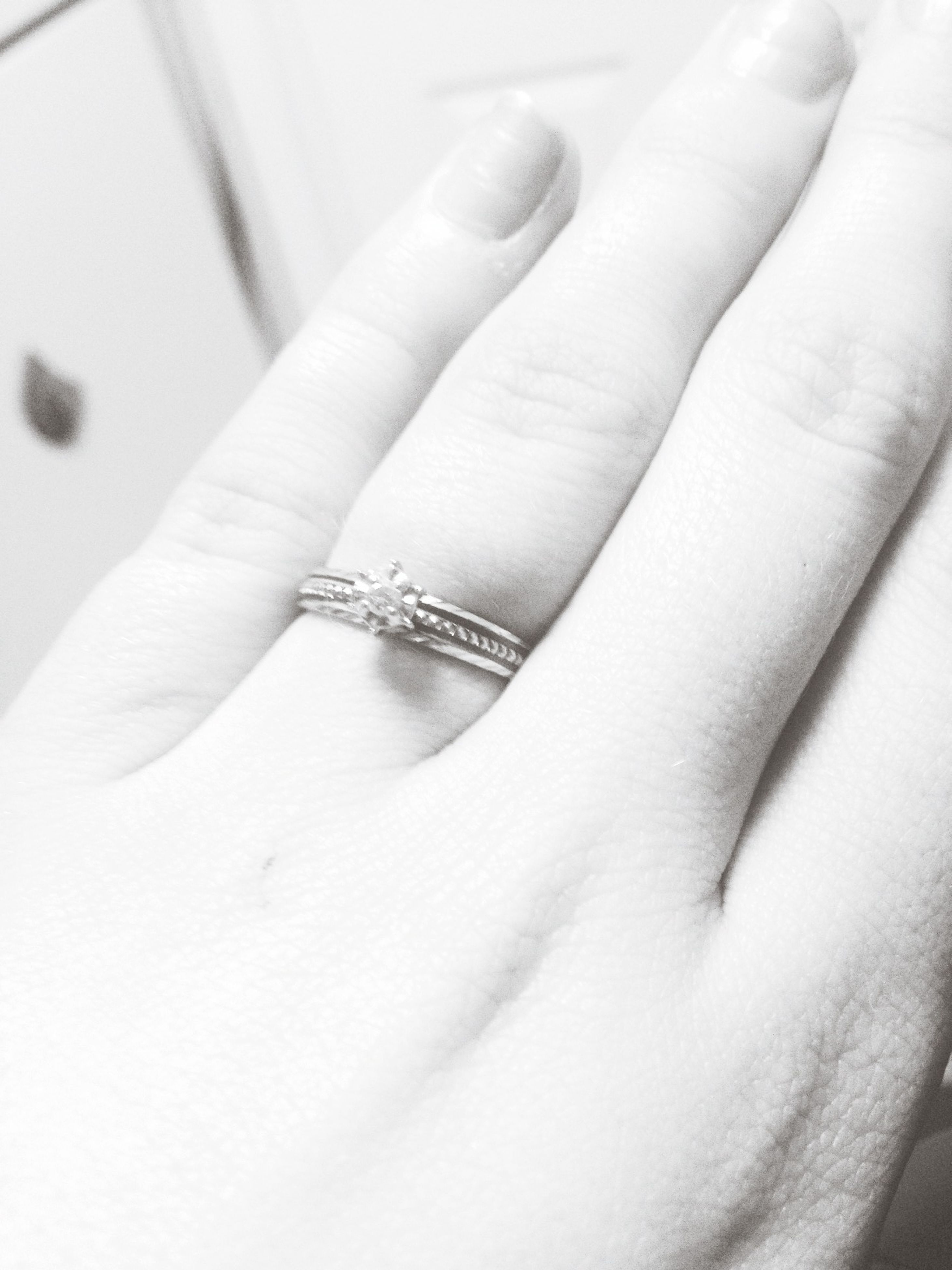 person, indoors, part of, close-up, cropped, human finger, holding, lifestyles, unrecognizable person, studio shot, human skin, ring, selective focus, high angle view, detail, leisure activity