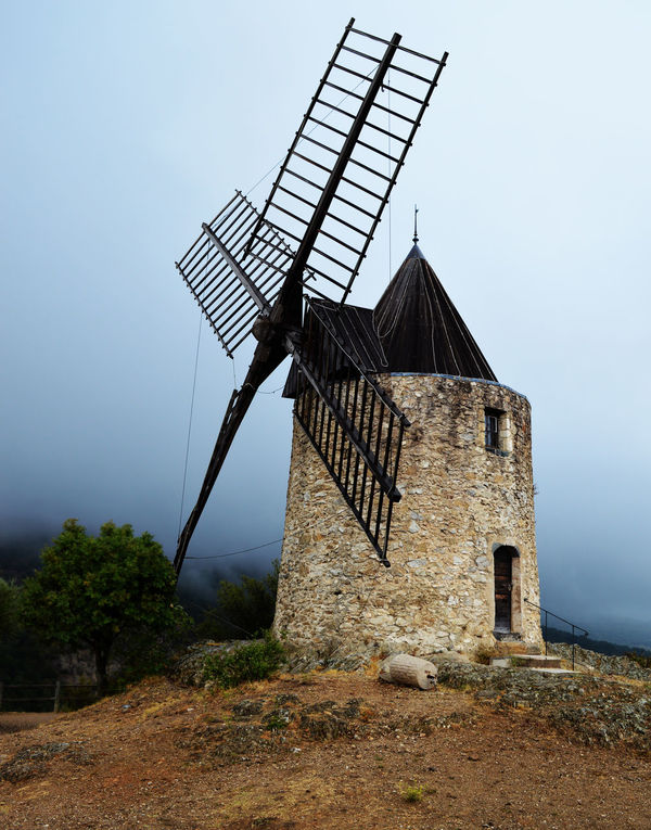 Alternative Energy Architecture Building Exterior Built Structure Day Environmental Conservation Fuel And Power Generation Nature No People Outdoors Renewable Energy Rural Scene Sky Traditional Windmill Wind Power Wind Turbine Windmill