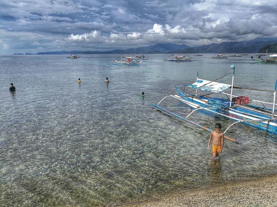 Young fisherman Sea Beach Water Beauty In Nature Cloud - Sky Outdoors Nature Landscape Philippines EyeEm Nature Lover Beauty In Nature Travel EyeEm Best Shots Nautical Vessel Sky Scenics Day Nature Sabang Palawan Sand Live For The Story Lost In The Landscape