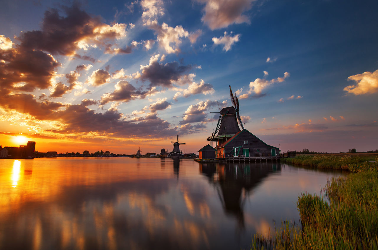 Preserved historic windmills and houses from Zaanse Schans, Netherlands. Architecture Building Exterior Cloud - Sky Europe Exterior Holland Lake Landmark Netherlands No People Outdoors Reflection Sky Sunset Traditional Windmill Travel Destinations Vacation Water Windmill Zaanse Schans