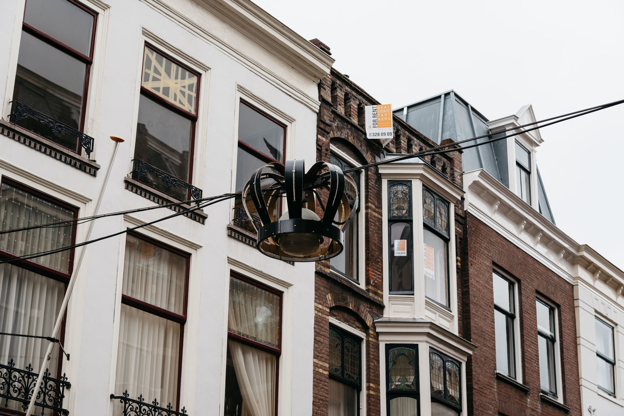 Typical houses in The Hague, low angle view Architecture Building Exterior Built Structure City City Cityscape Clear Sky Day Low Angle View Low Angle View No People Outdoors Sky Street Light The Hague Tranquility Travel Destinations Typical Typical Houses Window