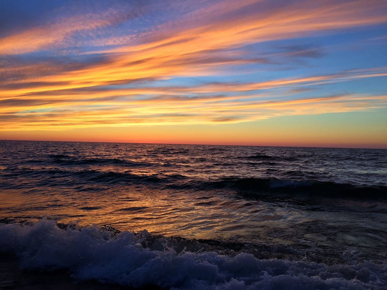 Fair Winds and Following Seas Sunset Horizon Over Water Water Beach Wave No People Outdoors Lake Superior Pure Michigan Sky Sea Beauty In Nature Tranquil Scene Reflection