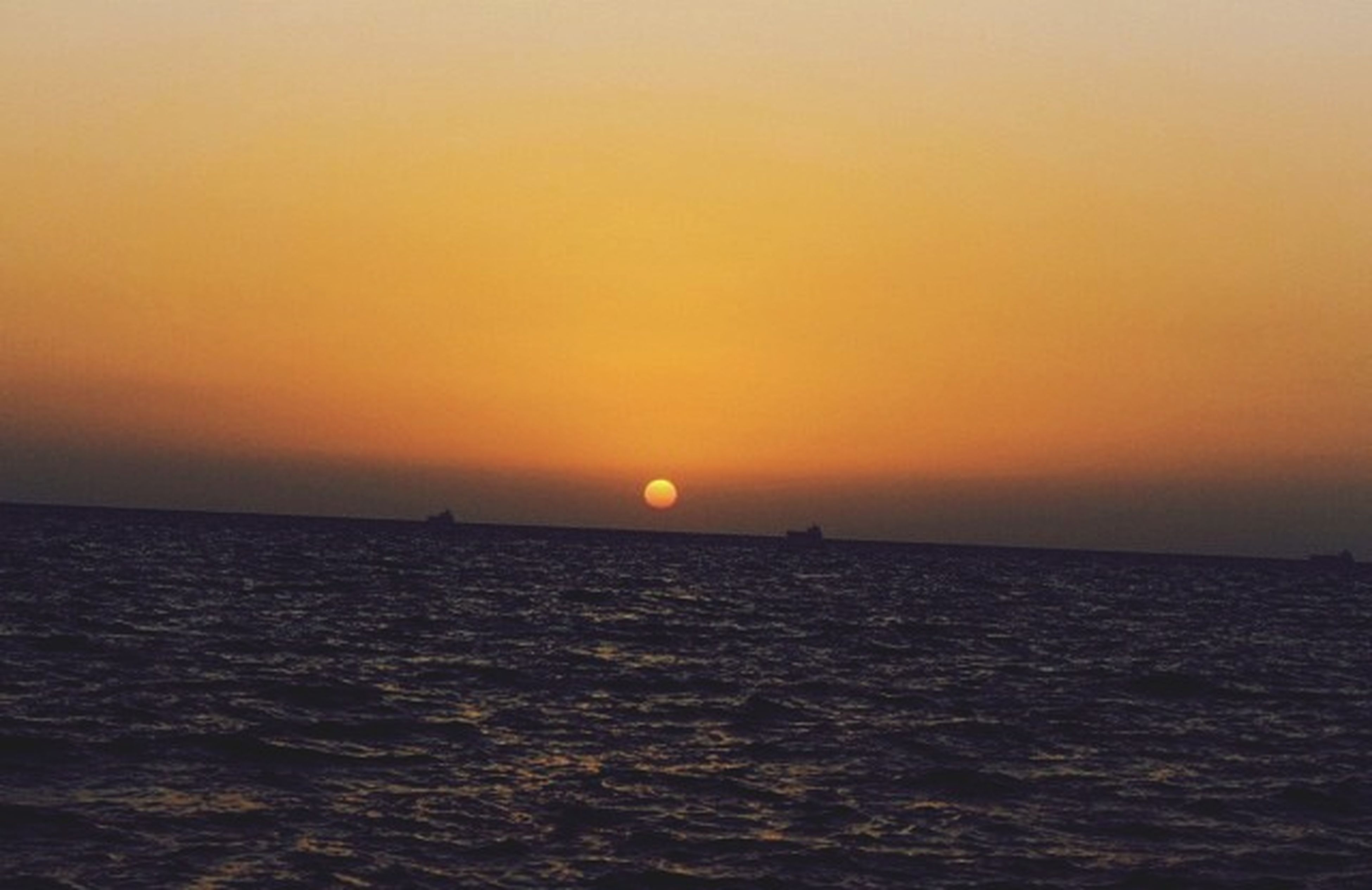 sea, sunset, water, horizon over water, waterfront, scenics, tranquil scene, sun, orange color, beauty in nature, tranquility, rippled, idyllic, nature, copy space, clear sky, seascape, sky, outdoors, no people