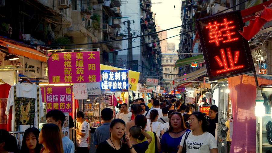 Asian Culture Market Wuhan Architecture Building Exterior Built Structure China Chinese Culture City Communication Crowd Illuminated Large Group Of People Market Stall Men Neon Outdoors Real People Street Fashion Text Women