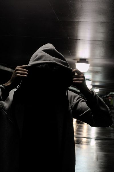 Anonymous Close-up Day Hood Hooded Parrot Horizon Over Water Human Hand Illuminated Indoors  Leisure Activity Lifestyles Men Mysterious Mystery One Person People Real People Scary Shadow Shadows & Lights Standing