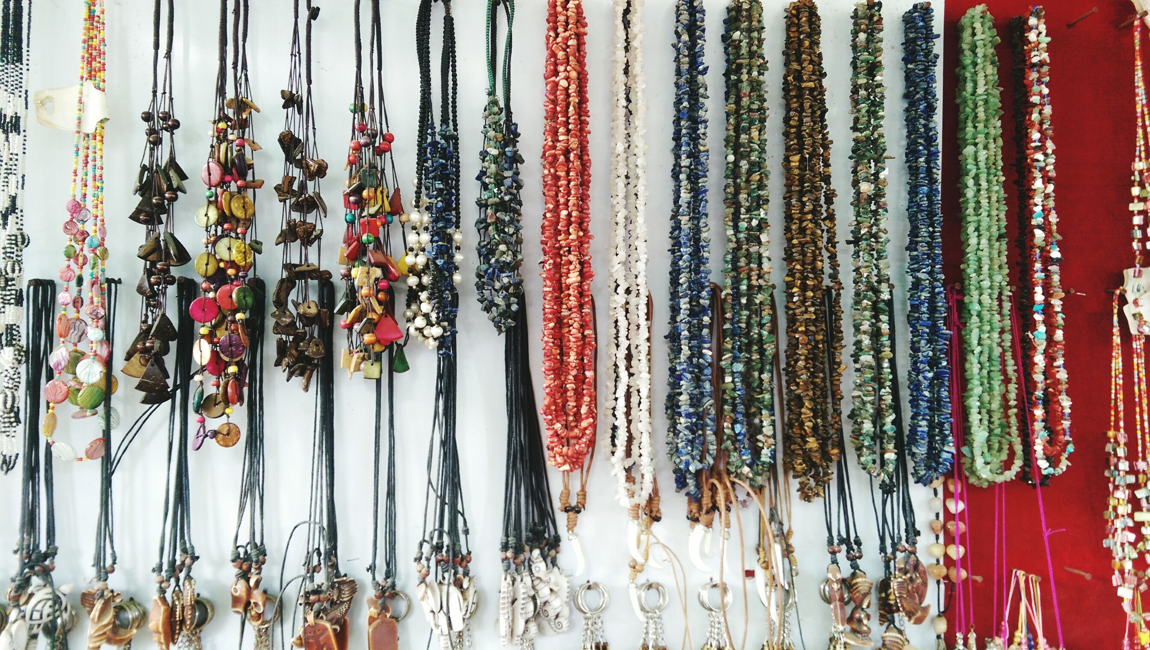 variation, hanging, large group of objects, choice, abundance, arrangement, in a row, for sale, order, multi colored, retail, side by side, collection, indoors, full frame, still life, backgrounds, display, market, textile