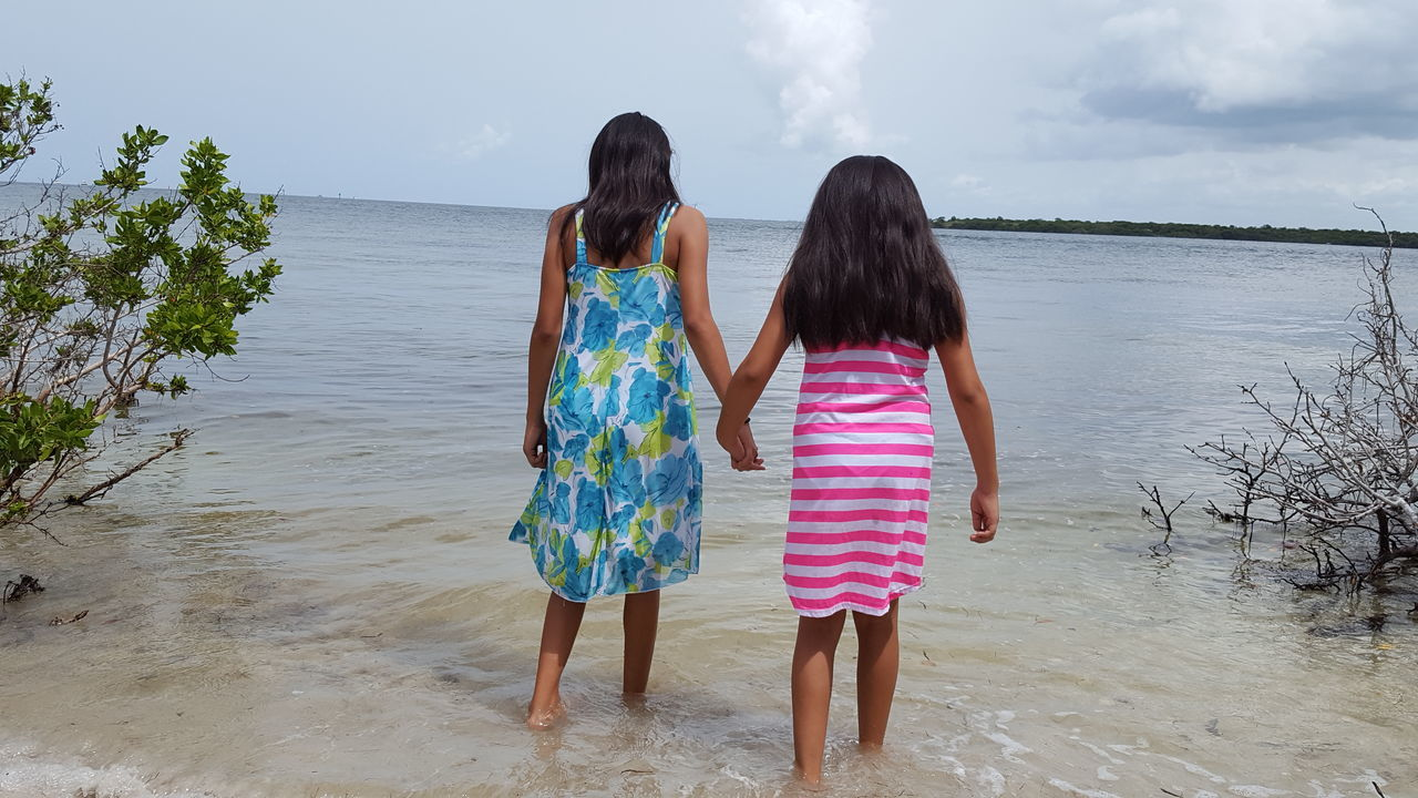 Hold my hand sister. Everything will be okay Sisters Holding Hands Okay Wading Desoto National Park Family Time Family Bradenton FL Florida Life