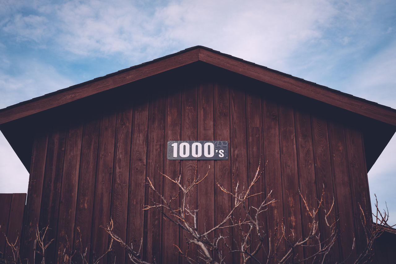 Architecture Building Exterior Built Structure Communication Day Garage Garden Looking Up No People Outdoors Sky Text Western Script Wood - Material