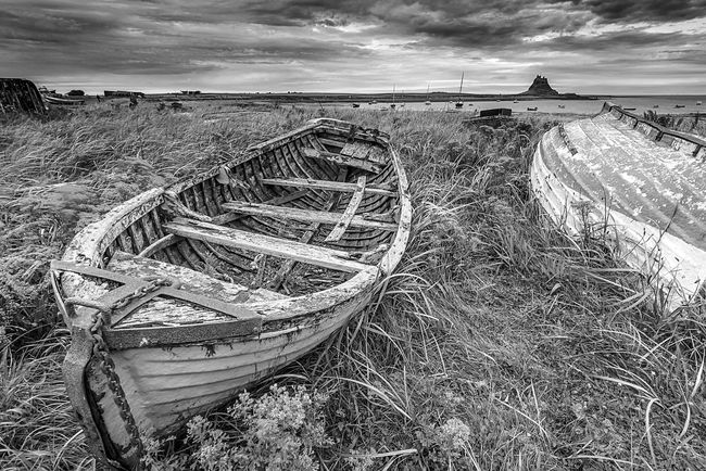 Beached Beach Tranquility Shore Nautical Vessel Boat Scenics Beauty In Nature My Favorite Place Seaside Coastline Lindisfarne Northumberland EyeEm Masterclass Landscape Sea And Sky Sea View Travel Destinations Seascape Tranquil Scene Bw Photography BW Landscape Grassy Decay Sombre