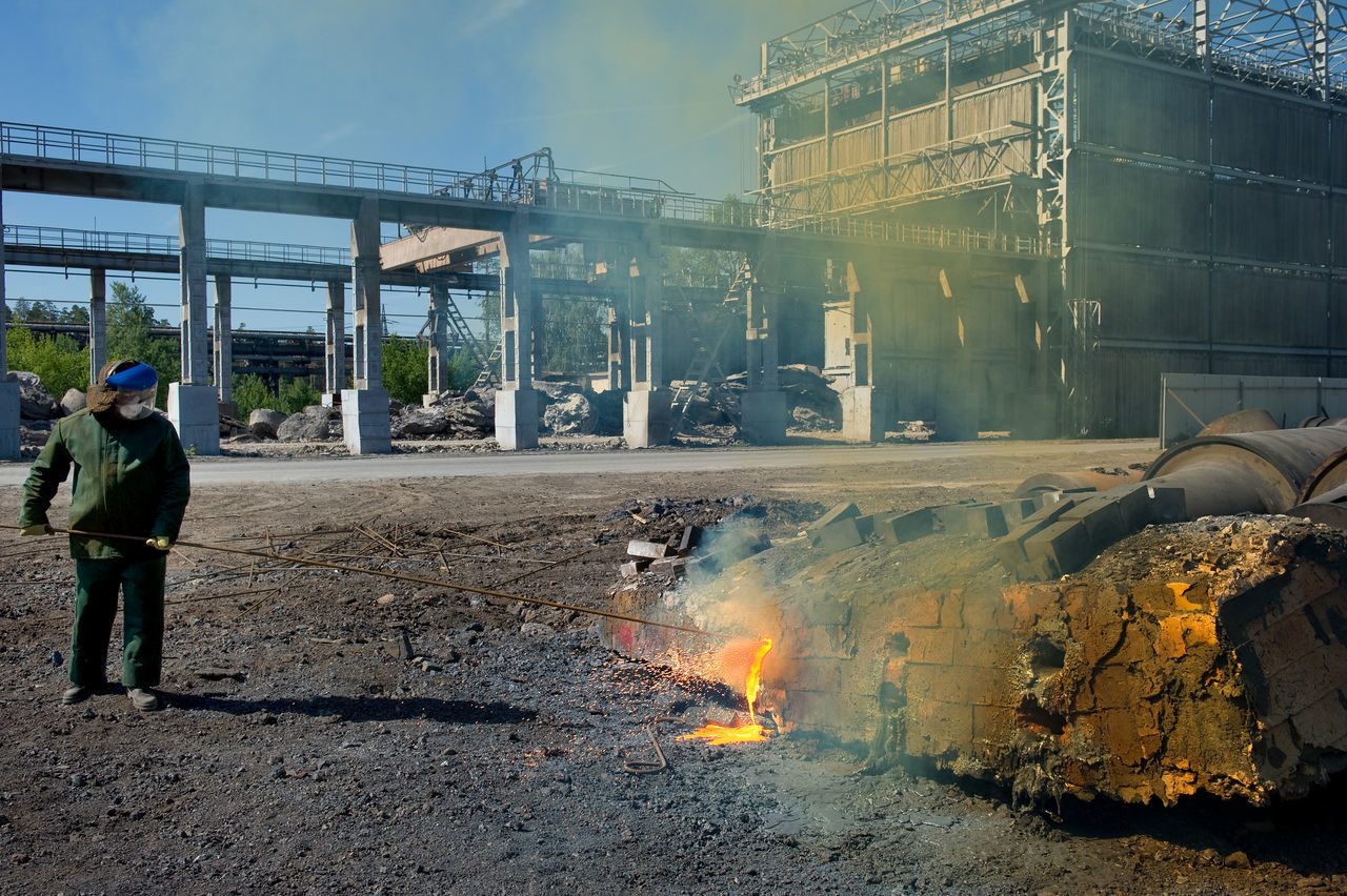 Russia, Lipetsk, processing of secondary metal, steel mill, engraver metal Architecture Building Built Structure Casual Clothing City City Life Day Engraver Metal Leisure Activity Lifestyles Lipetsk Outdoors Sky Smoke - Physical Structure