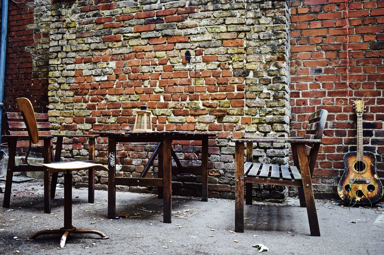brick wall, brick, chair, table, no people, day, architecture, indoors, built structure