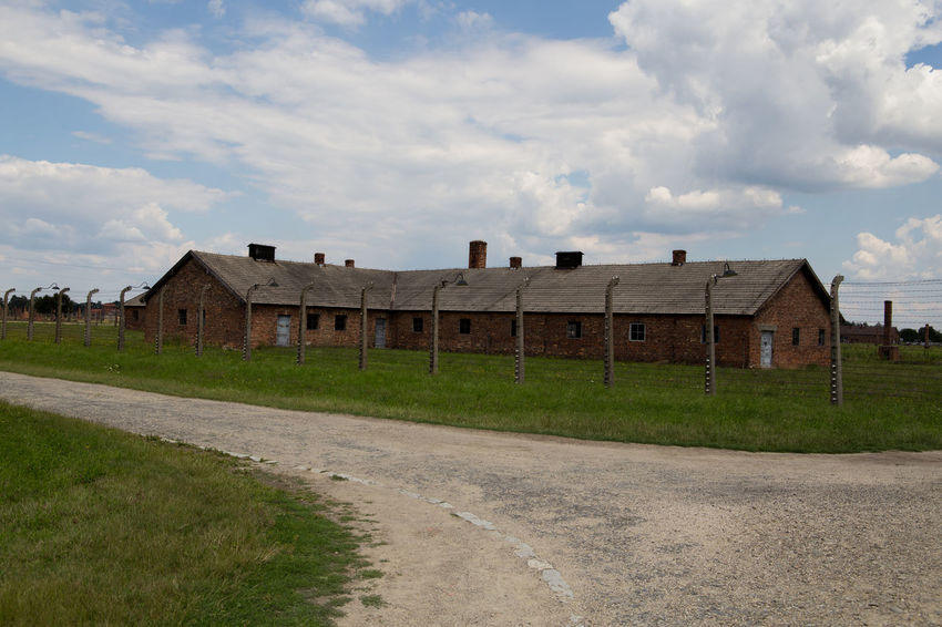 Aushwitz Aushwitz Residence Aushwitz-Birkenau Crakow Death Camp Eastern Europe Poland Architecture Aushwitz Camp Building Exterior Built Structure Cloud - Sky Concentration Camp Concentrationcamp Day Grass House Killing Krakow Landscape No People Outdoors Road Sad Sky