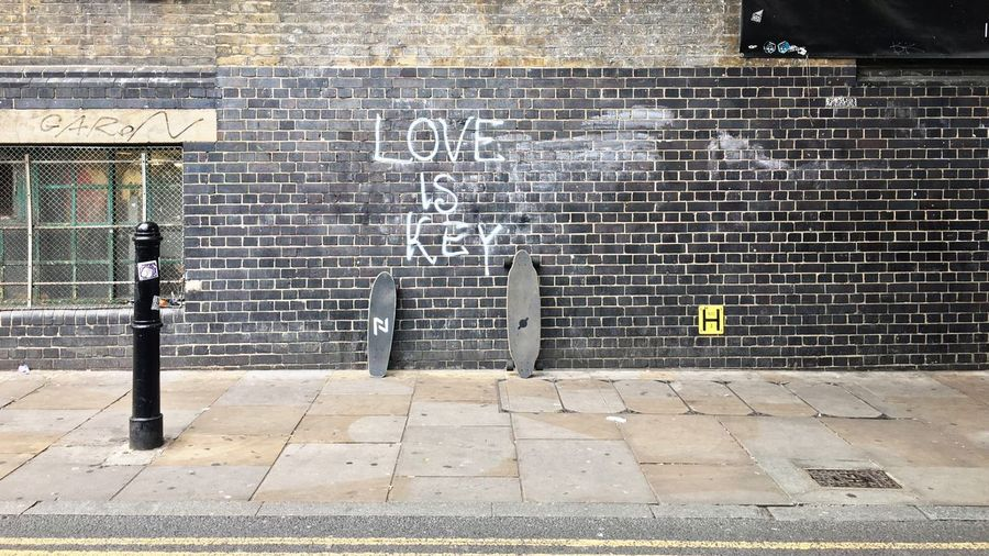 Brick Lane. Built Structure Architecture Text Outdoors Building Exterior Day Communication Sidewalk Blackboard  No People City Urban Graffiti