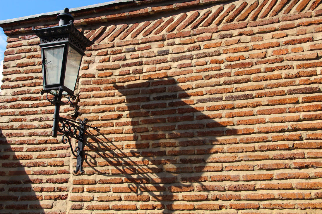 light and shade Architecture Brick Wall Day Exterior Geometry High Angle View House Lantern On The Wall Light And Shade No People Outdoors Pattern Shadows & Lights Street Lamp Town