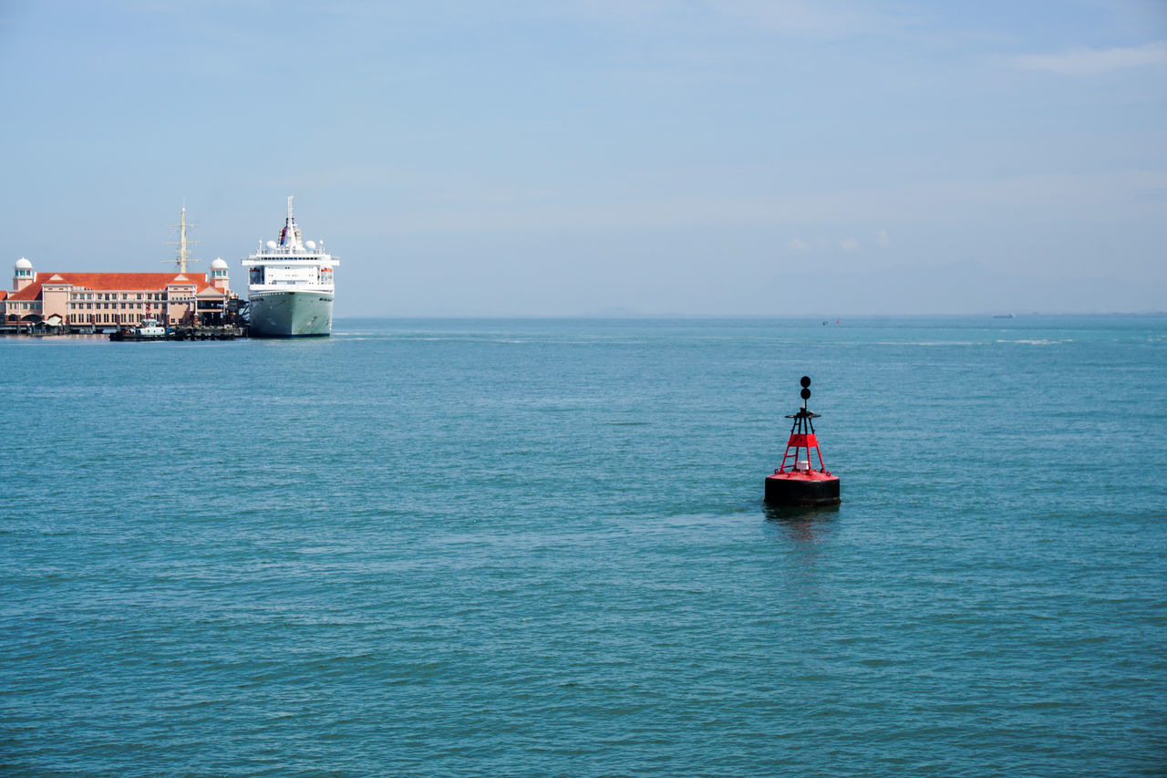 sea, water, lighthouse, horizon over water, safety, nautical vessel, tranquility, day, waterfront, nature, scenics, transportation, outdoors, guidance, no people, buoy, beauty in nature, sky, building exterior, sailing, clear sky