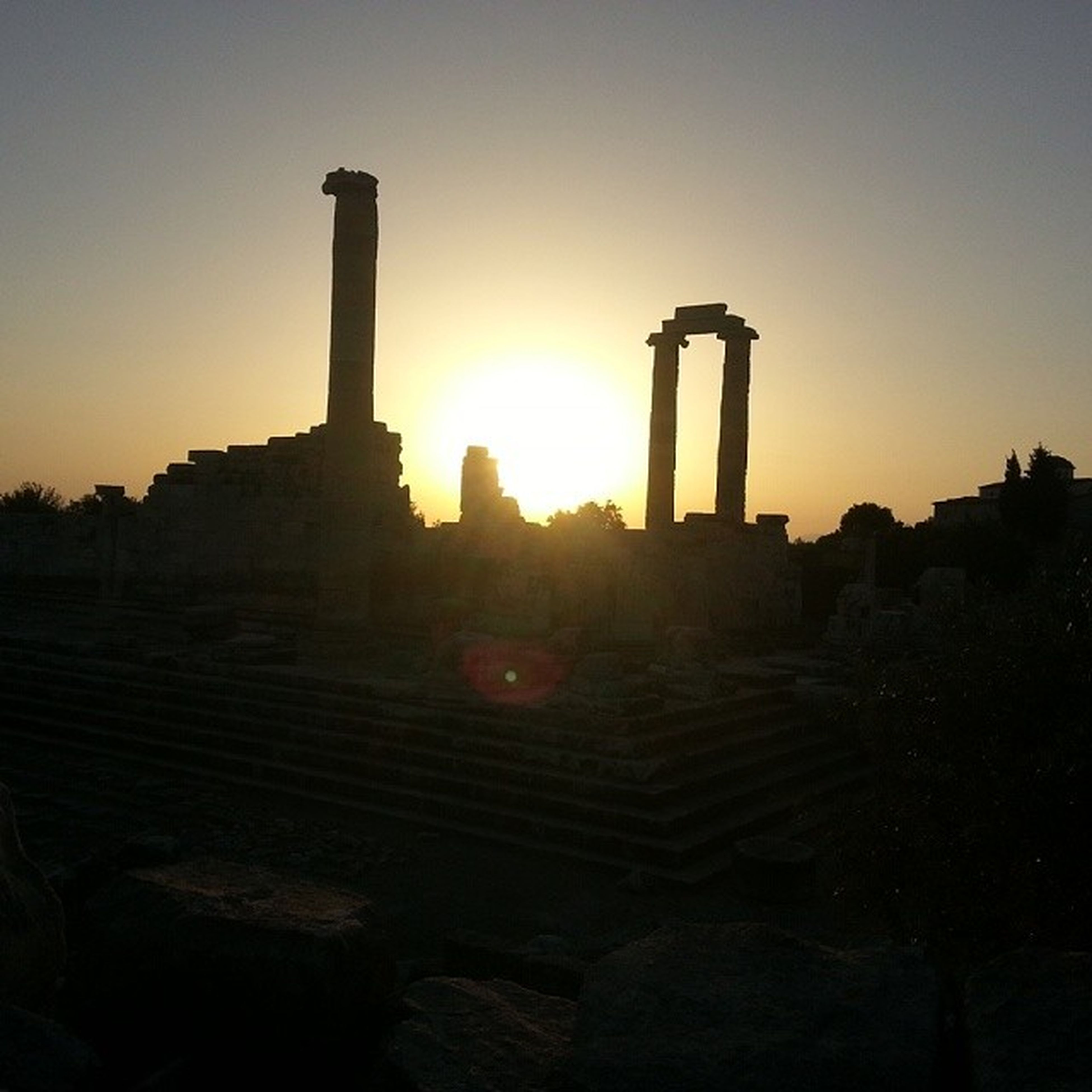 sunset, architecture, built structure, building exterior, sun, clear sky, history, silhouette, religion, famous place, travel destinations, ancient, place of worship, travel, spirituality, old ruin, tourism, sunlight, sky, the past