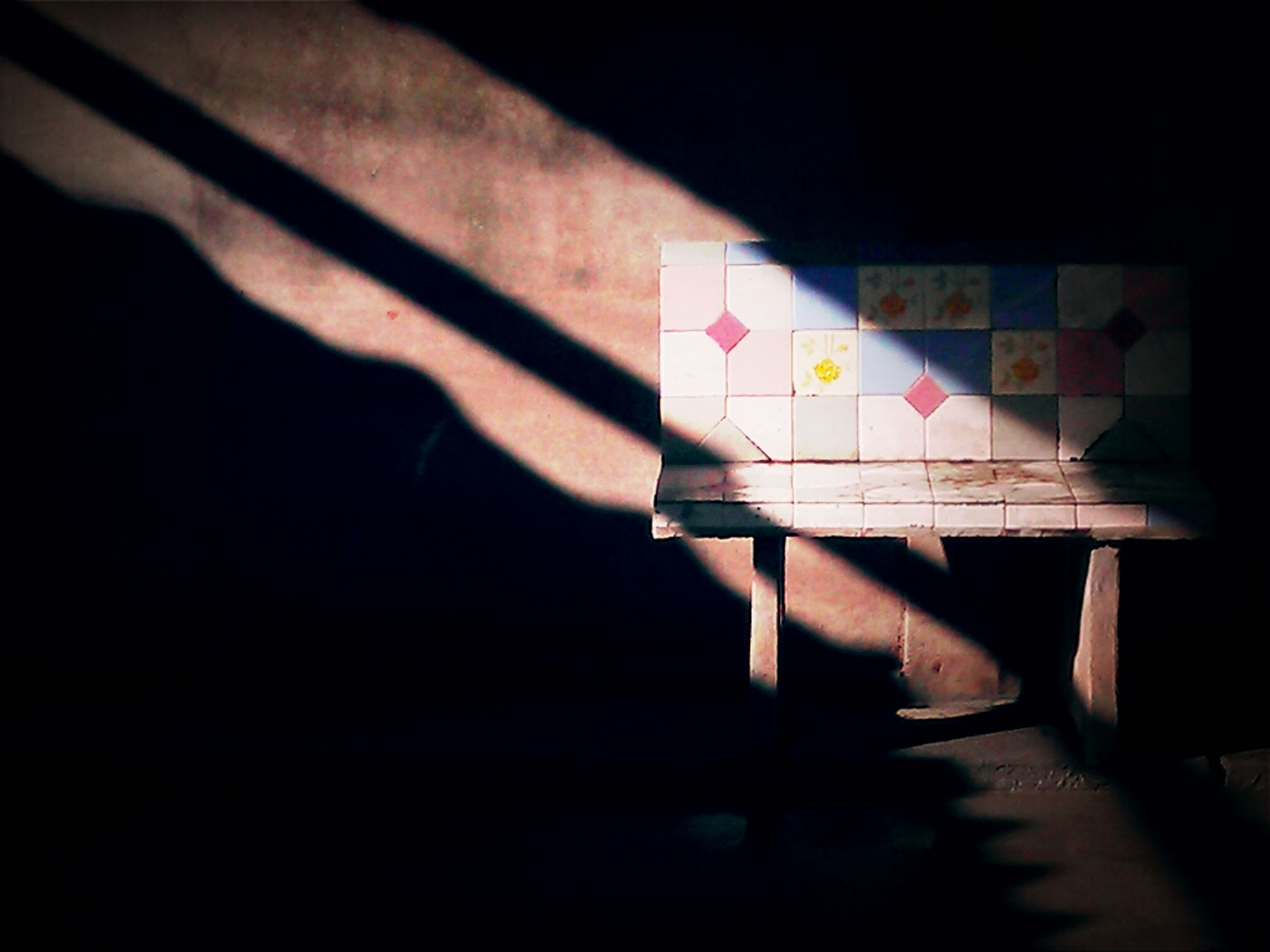 indoors, still life, multi colored, shadow, close-up, no people, paper, table, copy space, wood - material, wall - building feature, high angle view, art and craft, yellow, creativity, illuminated, hanging, selective focus, ideas, colorful