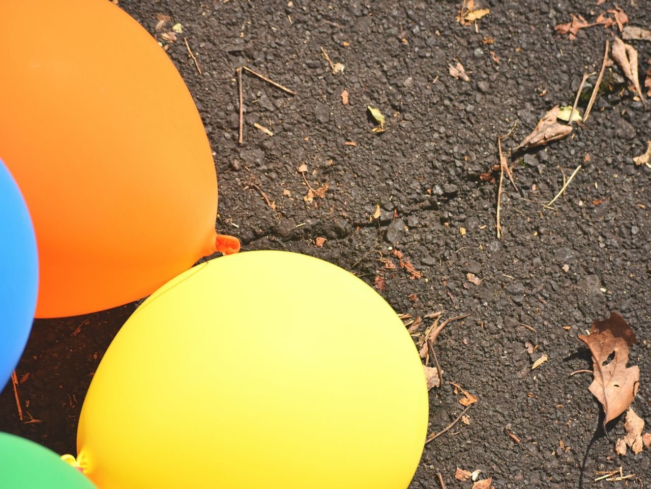 High Angle View Outdoors Day No People Close-up Trip Focus On Foreground Ground Level View Textures And Surfaces Balloons Ground Celebration Party Colorful Orange Color Yellow Streetphotography Carnival Crowds And Details Road Adventure Way