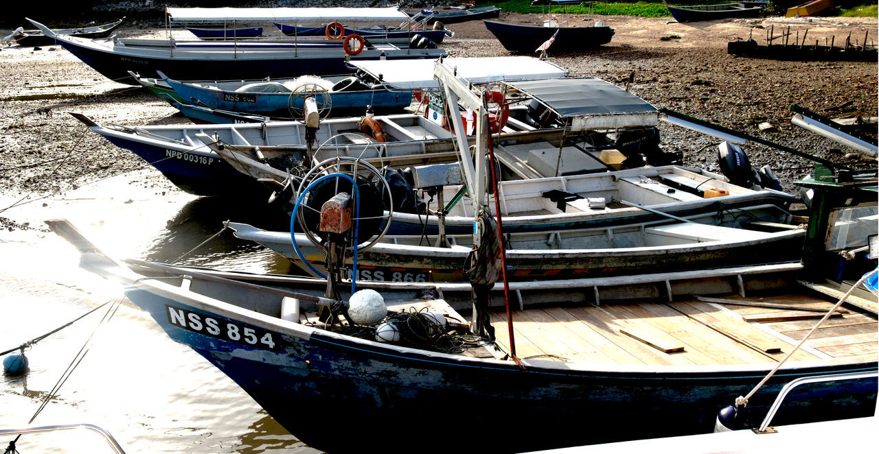 nautical vessel, transportation, moored, mode of transport, outdoors, boat, beach, day, sand, high angle view, water, no people, nature, sea