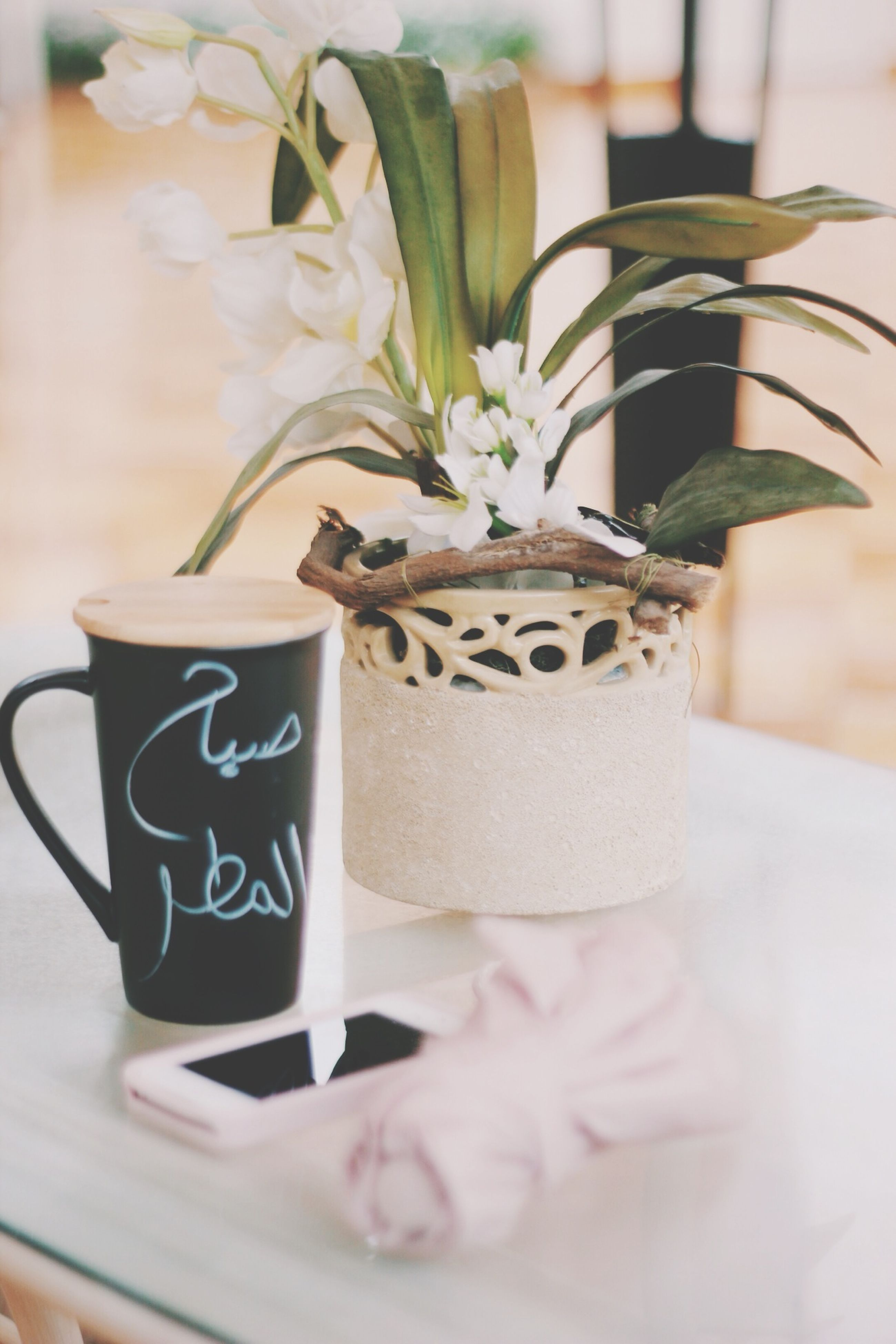 indoors, table, text, close-up, freshness, still life, western script, focus on foreground, food and drink, communication, flower, selective focus, creativity, vase, art, decoration, drink, art and craft, no people, human representation