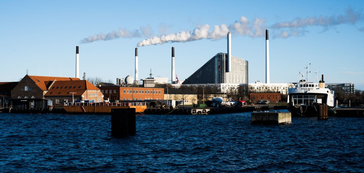 smoke stack, factory, industry, architecture, pollution, smoke - physical structure, waterfront, built structure, sky, water, emitting, day, no people, building exterior, outdoors, fumes, chimney, nautical vessel