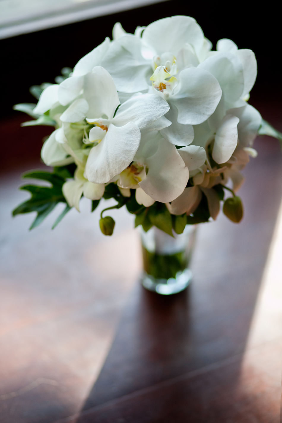 Bride's flower bouquet, White Orchids Beauty In Nature Bouquet Bride Close-up Day Flower Flower Head Fragility Freshness Growth Hand Bouquet Indoors  Light And Shadow Nature No People Petal Plant Table Vase Wedding White Orchid