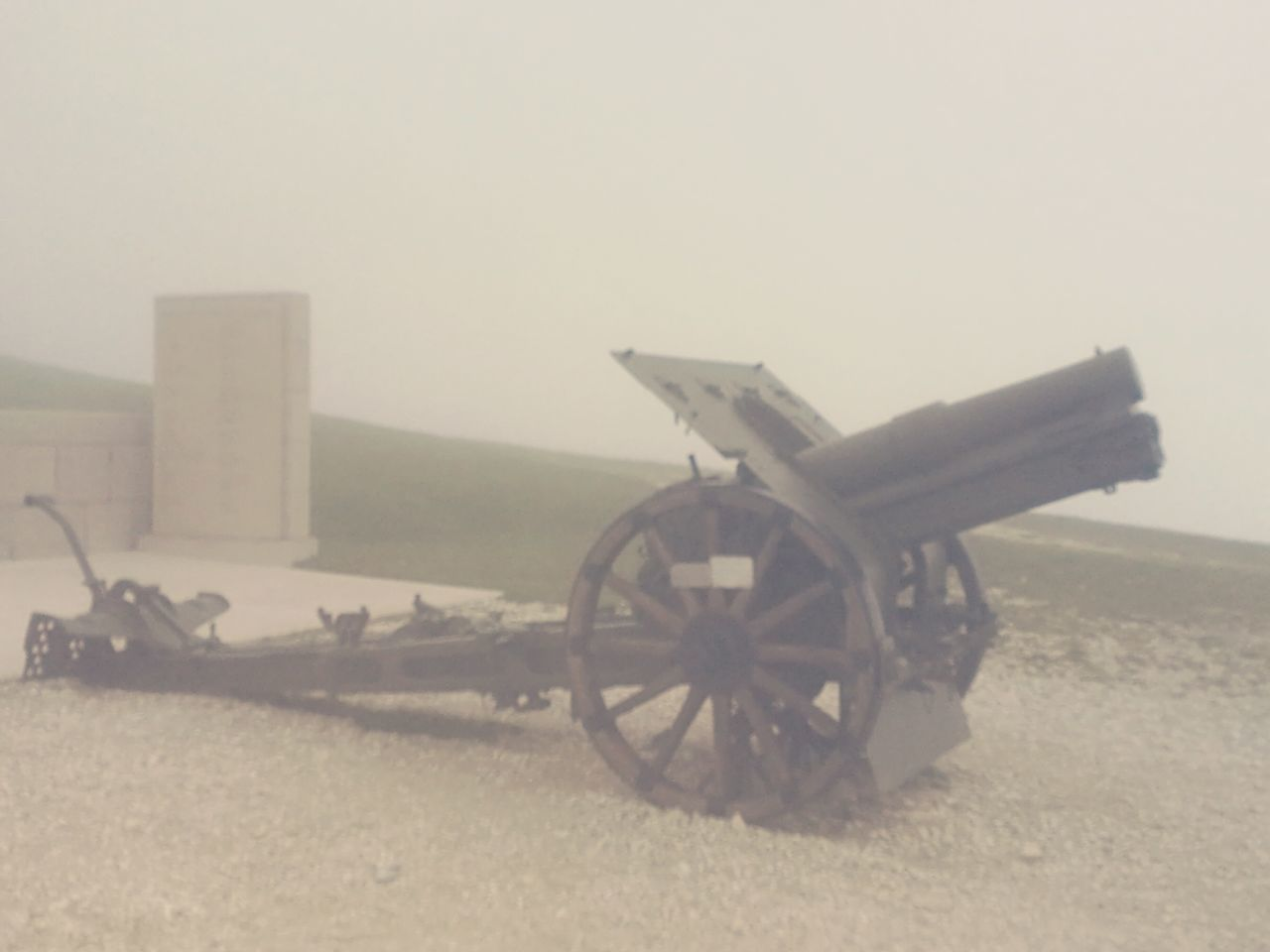 field, wheel, weapon, cannon, war, clear sky, no people, outdoors, transportation, old-fashioned, day, nature, canon, sky, military
