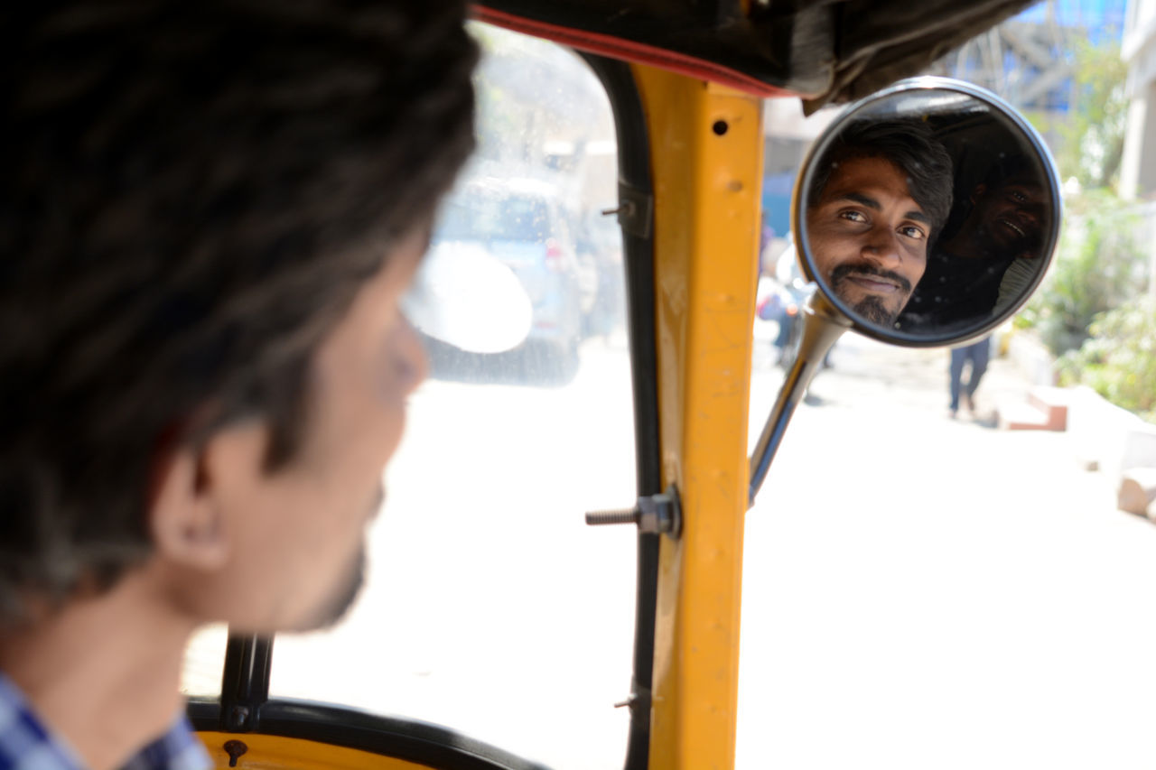 Portrait Of Jinrikisha Driver Seen From Rear-View Mirror