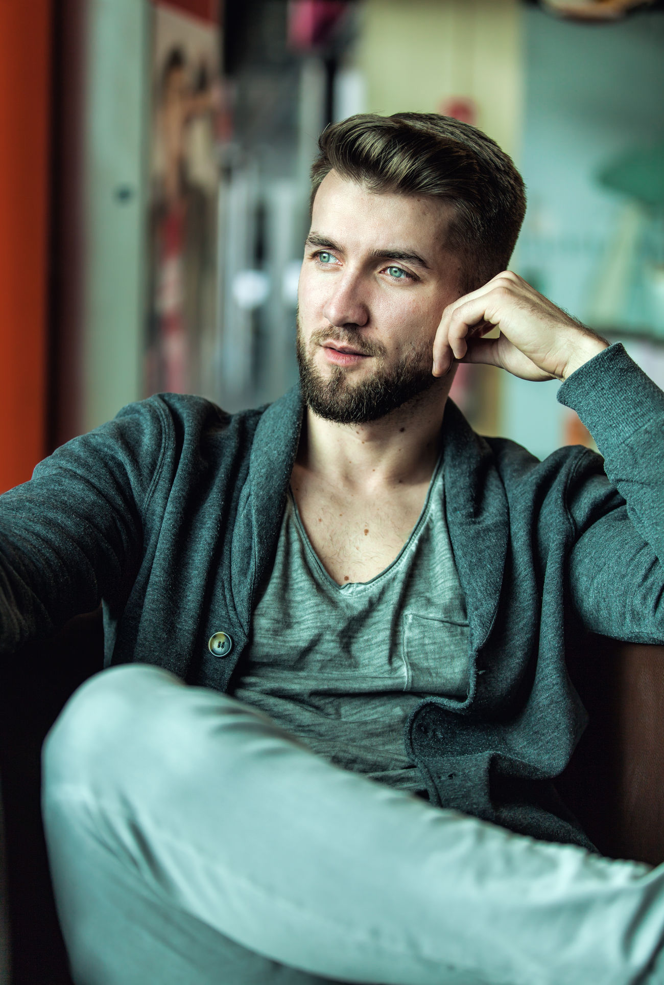 Attractive man with a beard is sitting in a coffee shop Background Beard Bearded City Close-up Fashion Guy Hairstyle Jeans Lean Lifestyles Looking Man Model One Outdoor People Person Portrait Restaurant Sitting Sportive Sweater Thinking Thoughful The Portraitist - 2017 EyeEm Awards