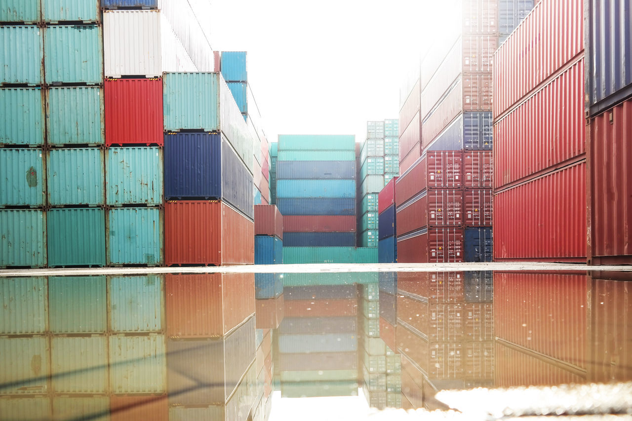 Business Business Finance And Industry Cargo Container Day Distribution Warehouse Export Freight Transportation Import Industry Multi Colored No People Outdoors Puddle Reflection Shipping  Shipping  Sky Trade Warehouse Water Water Reflections