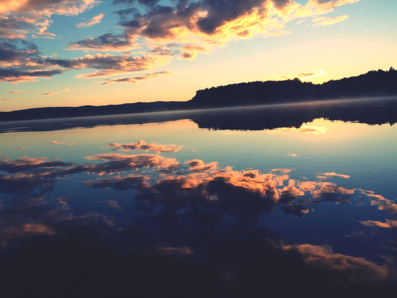 Sunset Scenics Tranquil Scene Reflection Beauty In Nature Tranquility Water Lake Idyllic Majestic Cloudscape Sky Cloud - Sky Orange Color Nature Awe Cloud Romantic Sky Calm Dramatic Sky
