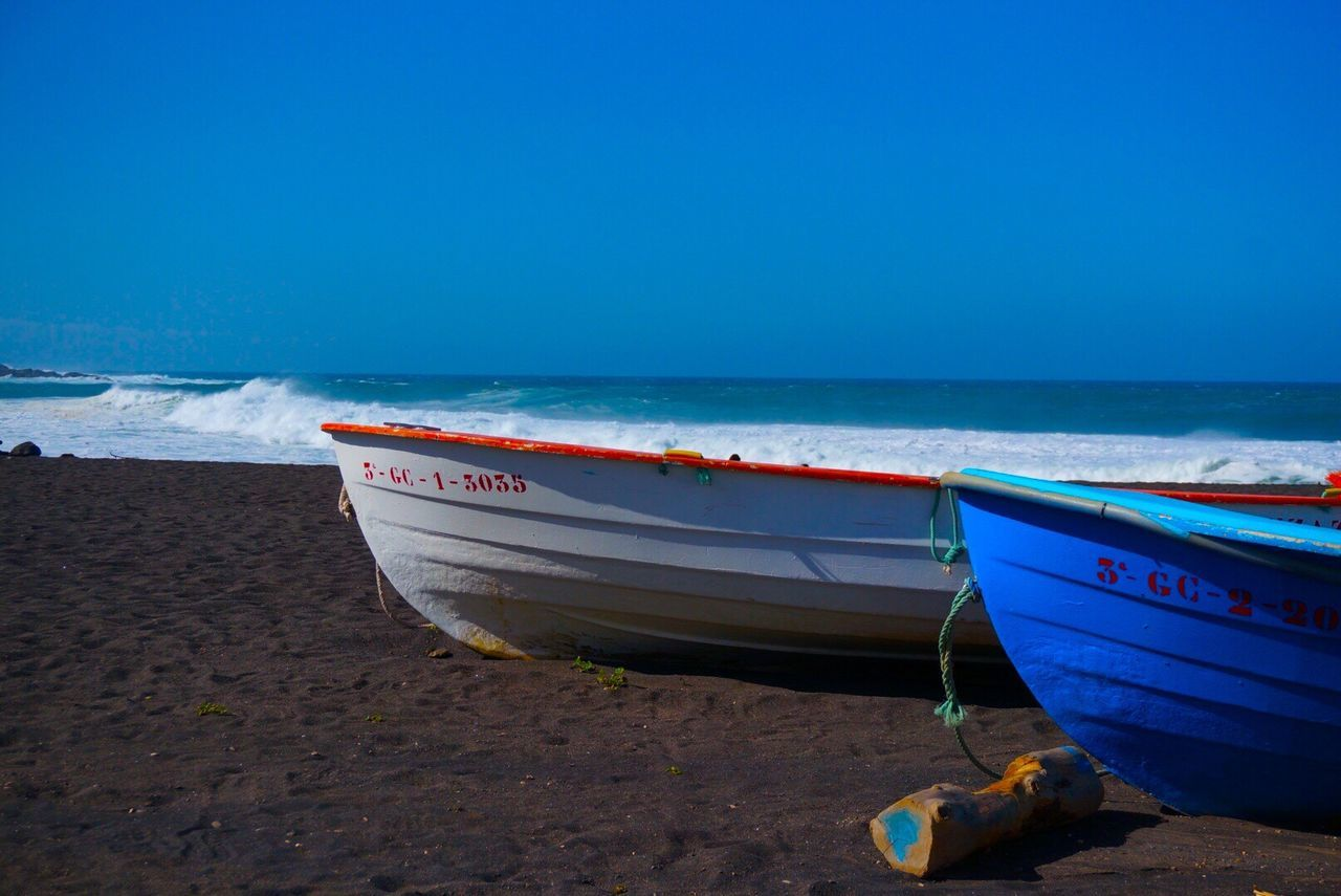 Sea Blue Beach Water Nautical Vessel Beauty In Nature Sand Nature Clear Sky Horizon Over Water Scenics SPAIN Fuerteventura Boat Fishing Boat Lava Landscape Wave Waves Waves, Ocean, Nature Nature Nature_collection Shootermag Showcase March Shore