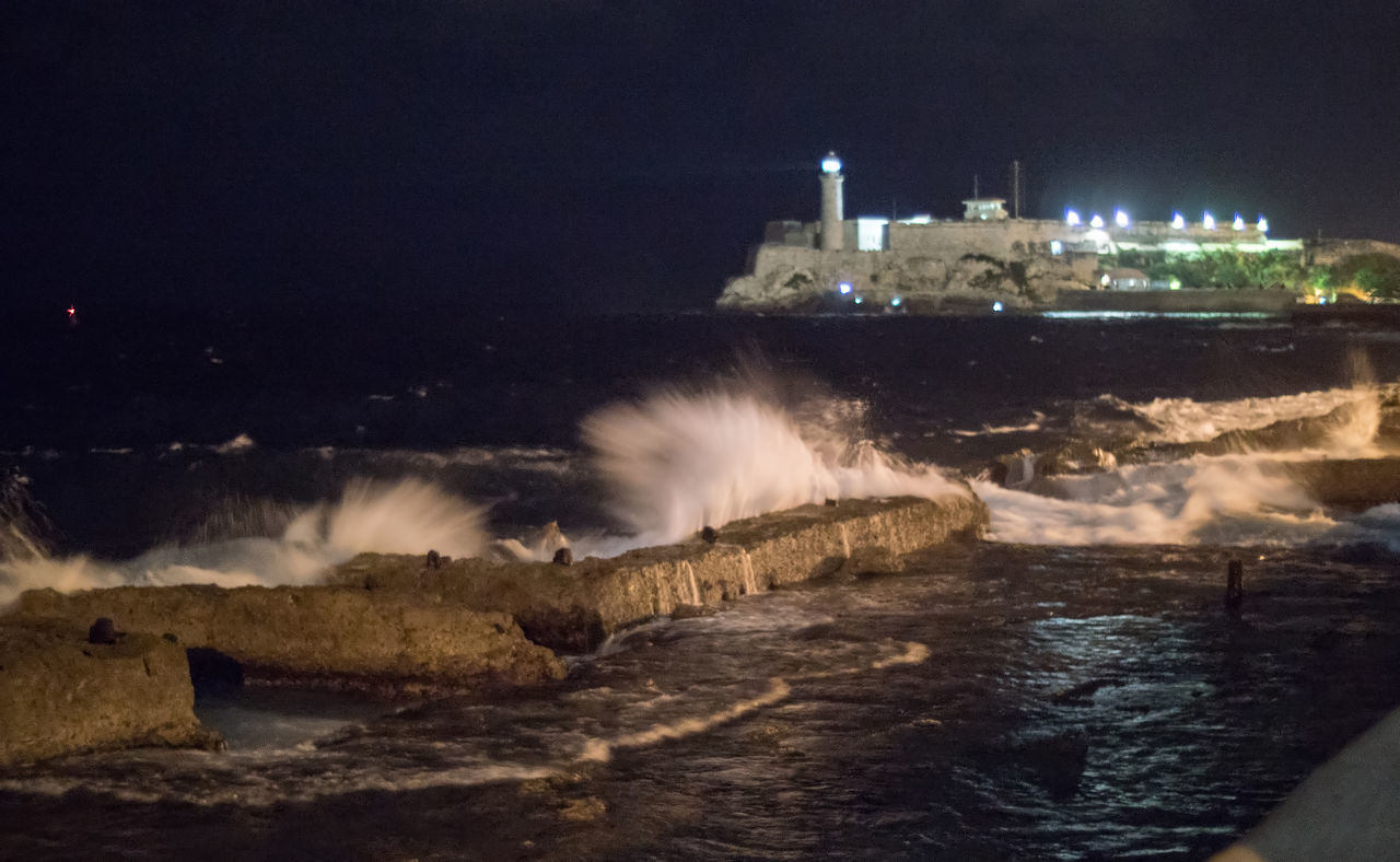 Malecon at night Cuba Cuba Collection Fortress Lighthouse Long Exposure Malecon Motion Night Night Lights Nightphotography No People Outdoors Sea Splashing Waves Travelling Photography Water