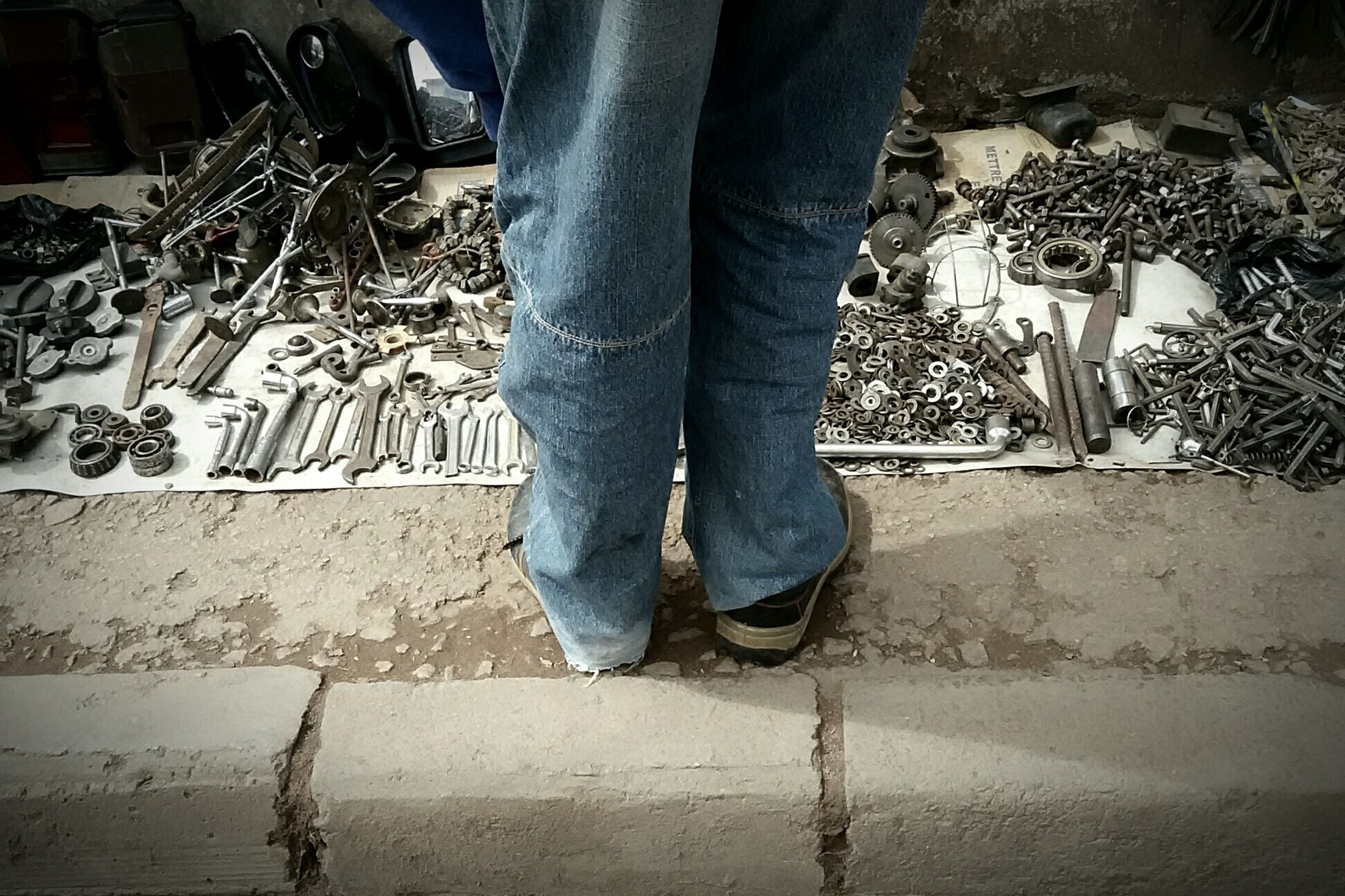low section, person, shoe, standing, lifestyles, men, street, jeans, human foot, casual clothing, leisure activity, sidewalk, footwear, outdoors, unrecognizable person, day