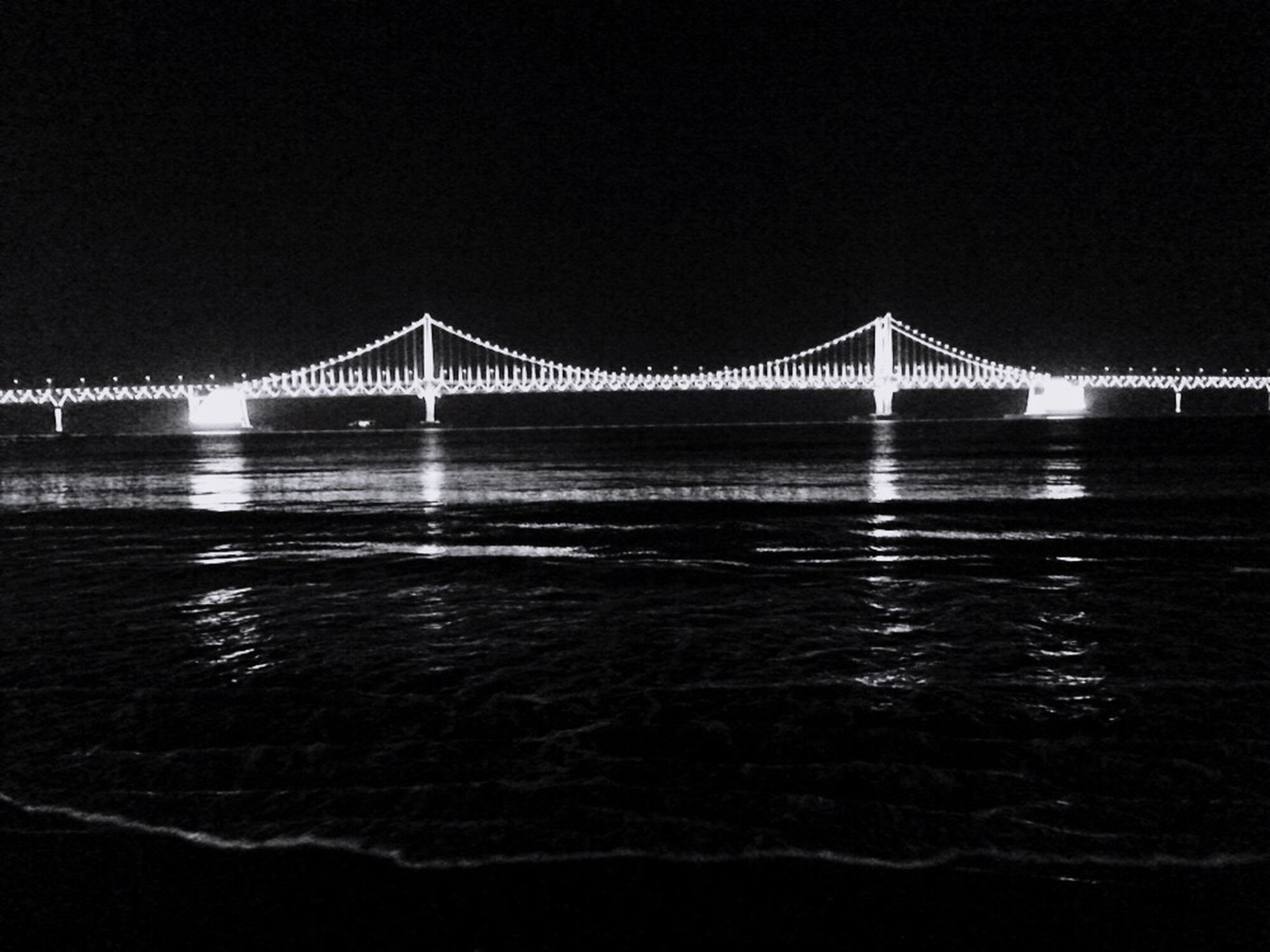 connection, bridge - man made structure, built structure, architecture, water, engineering, bridge, river, illuminated, suspension bridge, night, clear sky, waterfront, travel destinations, transportation, long, reflection, copy space, famous place, sea