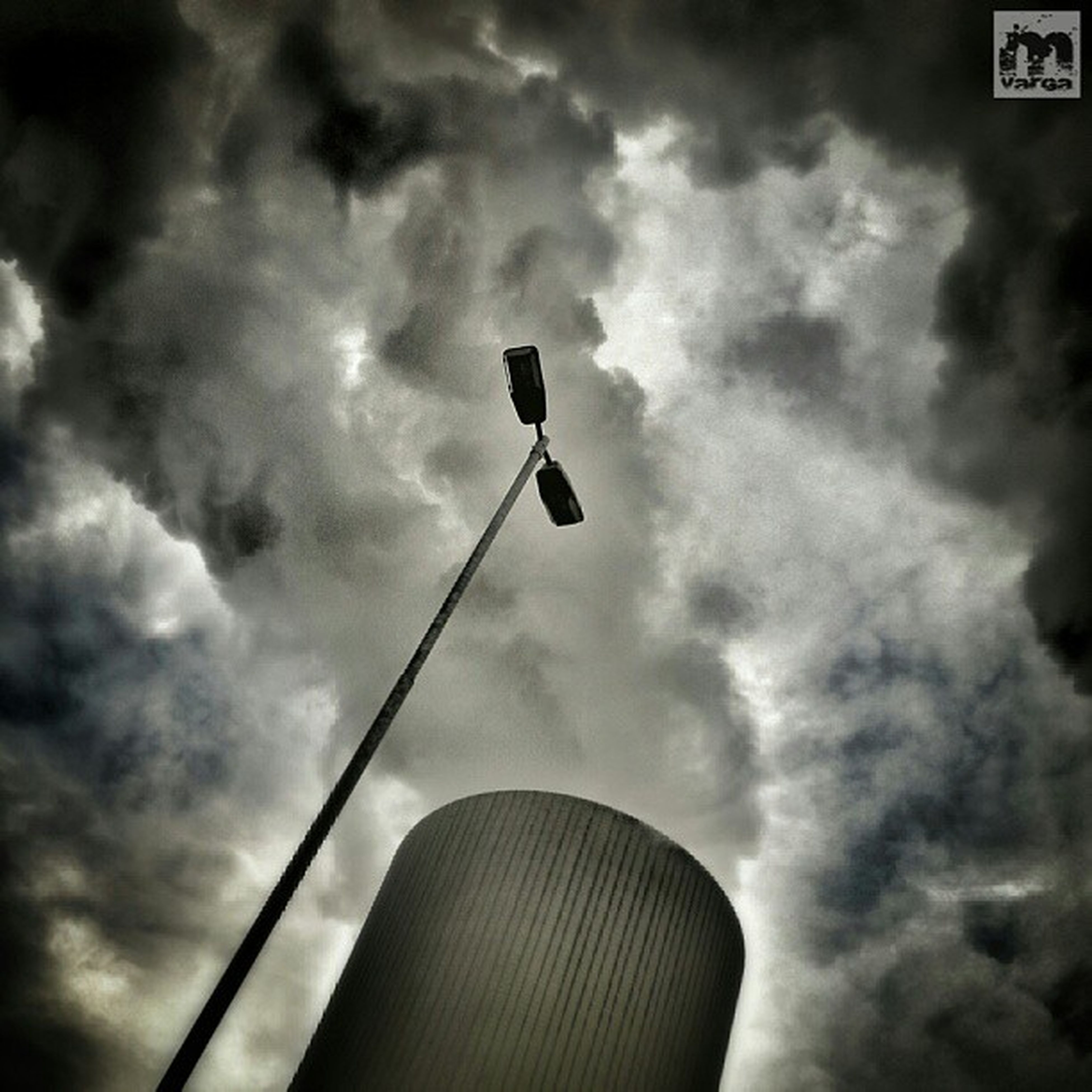 low angle view, sky, cloud - sky, cloudy, street light, cloud, lighting equipment, overcast, outdoors, no people, pole, day, flying, high section, weather, nature, dusk, mid-air, built structure, silhouette