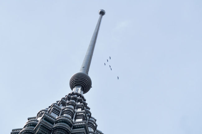 Peak of Petronas Twin Towers, also known as KLCC Tower - the tallest buildings in the world from 1998 to 2004 and remain the tallest twin towers in the world. Architectural Column Bird Clear Sky Flying High Section Klcc KLCC Park KLCC Tower KLCC Twin Towers KLCCAquarium Klccpark KLCCTwinTower Low Angle View Mid-air No People Outdoors Petronas Tower Petronas Towers  Petronas Twin Towers Petronas Twin Towers Walkway Petronastwintowers Sky Spire  Tall Tourism