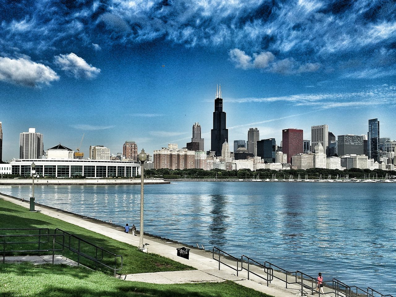 architecture, built structure, building exterior, water, sky, skyscraper, city, cloud - sky, day, river, modern, cityscape, outdoors, blue, urban skyline, growth, travel destinations, no people, nature
