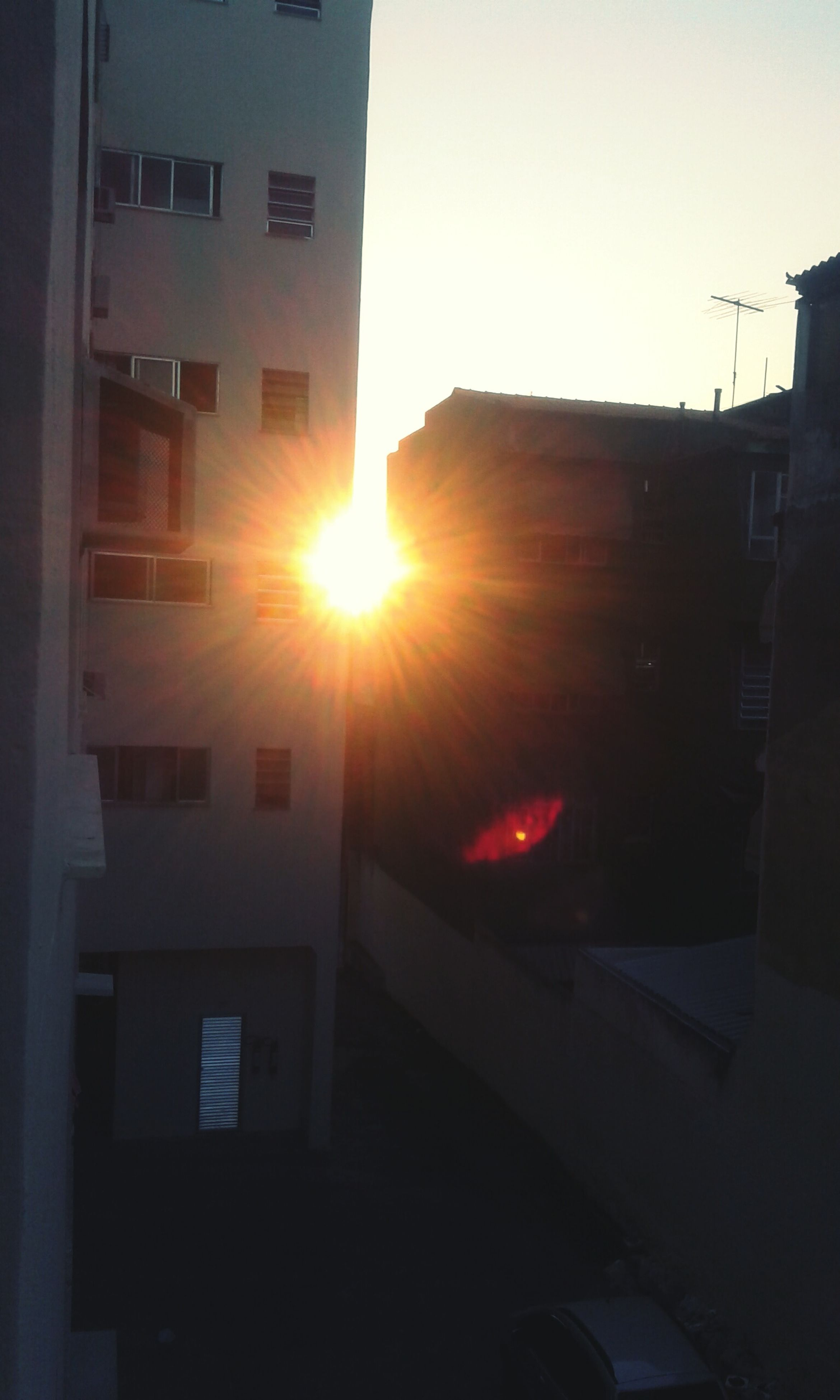 sun, built structure, architecture, building exterior, sunlight, sunbeam, sunset, house, lens flare, window, residential structure, clear sky, residential building, building, silhouette, city, outdoors, no people, bright, day