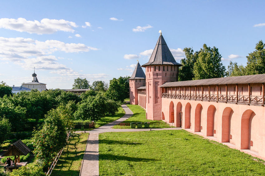 The wall of the Saviour Monastery of St. Euthymius, Russia, Suzdal Russia. Suzdal Architecture Architecture Building Built Structure Day Golden Ring Golden Ring Of Russia Grass Landmark Monastery No People Orthodox Outdoors Russia Sigth Sky Summer Suzdal Tower Tree Wall