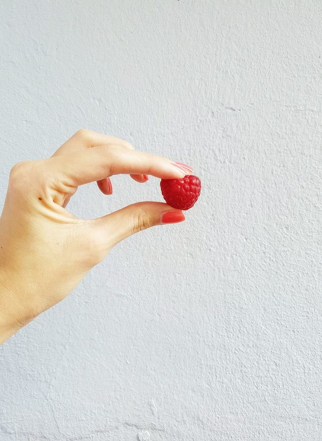 Fruitilicious Cropped Female Hand Fingers Holding A Fruit Raspberry Berry Fruits Red Fruits Nail Polish Red Nails Minimalism Wall Pastel Wall Healthy Eating Healthy Lifestyle Showcase April Spring Getting Fit Vegetarian Foodphotography Fruitphotography Burst Of Color No People Textures And Surfaces
