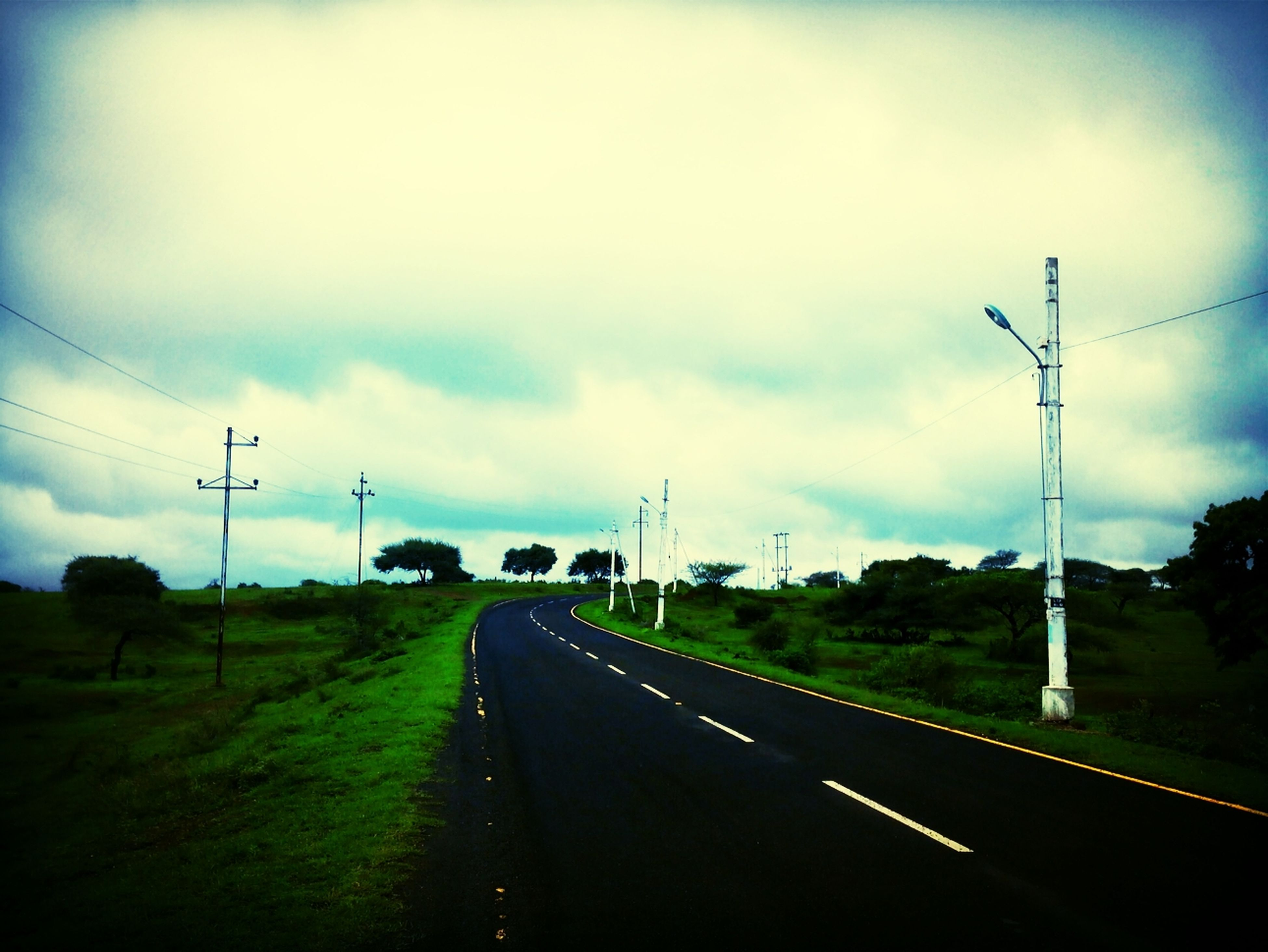 the way forward, transportation, sky, road, diminishing perspective, electricity pylon, cloud - sky, vanishing point, road marking, cloudy, power line, electricity, landscape, country road, connection, street light, cloud, empty road, power supply, tree