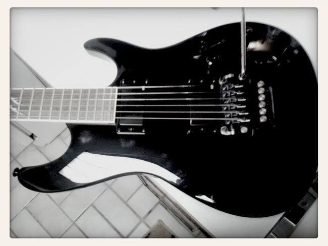 Getting photo fancy with my new guitar. Wondering what I should name her.
