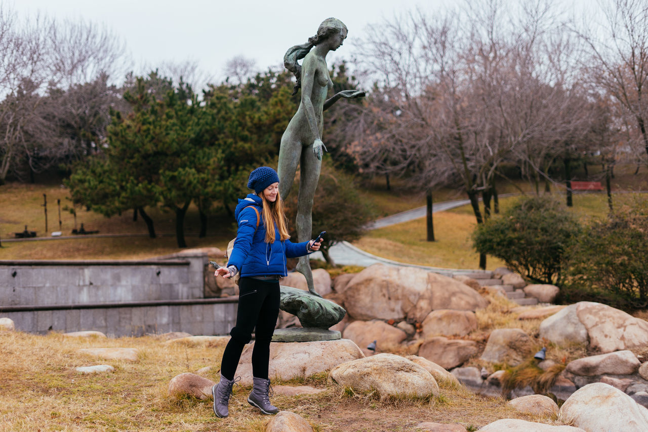Sculpture park exploring Outdoors Adventure Beauty In Nature Nature Travel Lifestyles Real People Female Sculpture Playful Park Exploring ASIA China Coast Adventures Tourism Tourist