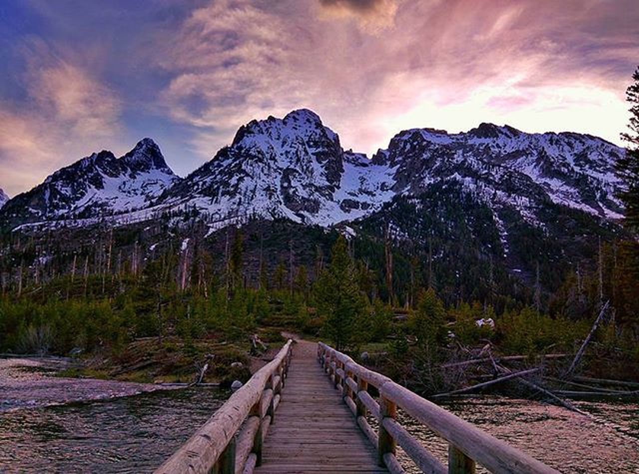 Bridge to a Mountain Wonderland. Mountains Grandtetonnationalpark Nationalpark Latergram Nexus6 Landscape Landscapephotography USA Wyoming Rockies Findyourpark Bridge Tetons Grandtetons Sky River Trees Roadtrip Wanderlust Snapseed