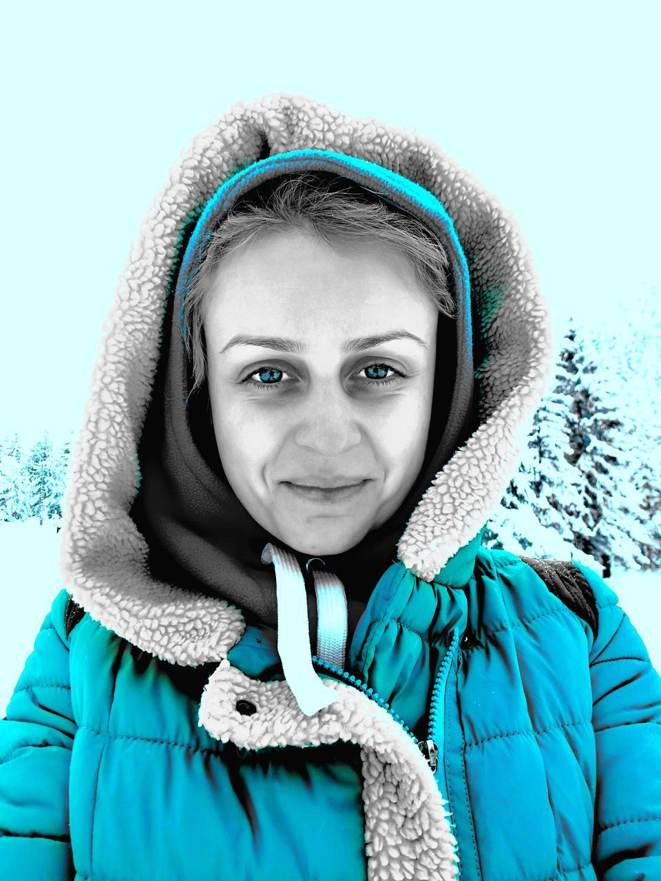 winter, looking at camera, snow, warm clothing, cold temperature, hood - clothing, portrait, real people, scarf, front view, jacket, lifestyles, one person, hooded shirt, day, outdoors, headshot, young women, close-up, nature, young adult