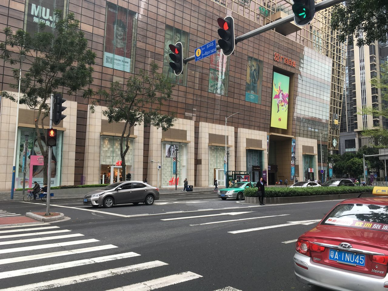 Architecture Building Exterior Built Structure Car City City Life City Street Day Guangzhou No People Outdoors Red Light Road Road Sign Skyscraper Stoplight Street Transportation Travel Destinations Tree Yellow Taxi