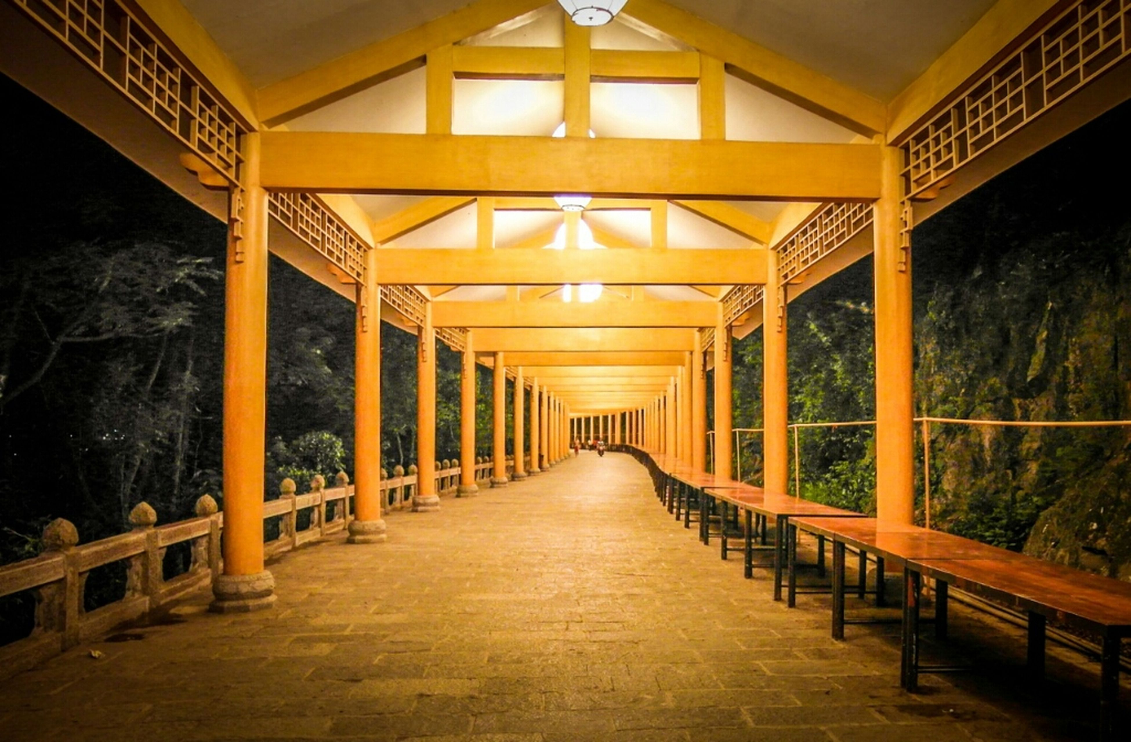 the way forward, diminishing perspective, built structure, architecture, vanishing point, indoors, illuminated, empty, long, ceiling, corridor, narrow, lighting equipment, walkway, absence, no people, railing, in a row, architectural column, connection