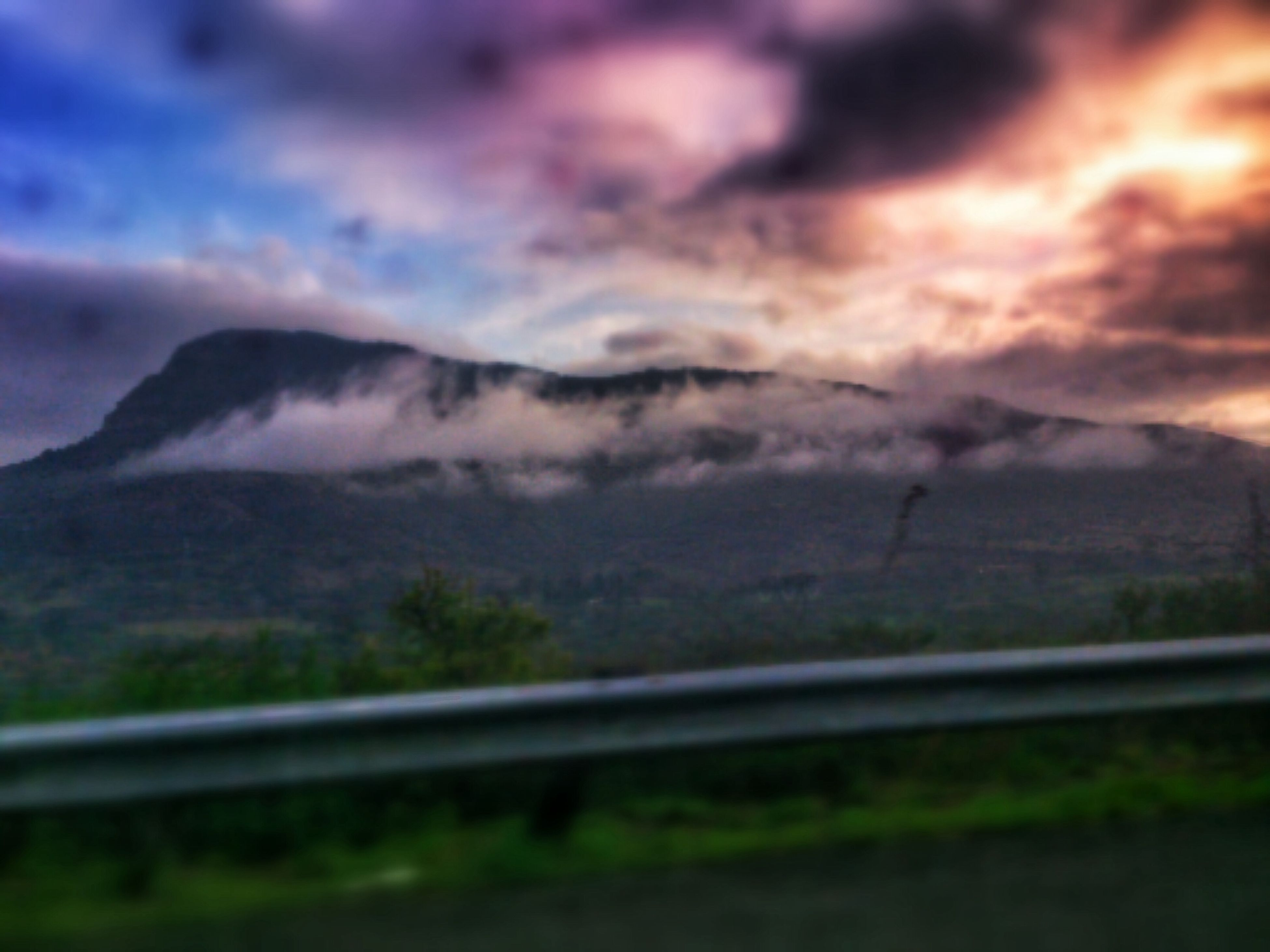 mountain, sky, landscape, tranquil scene, tranquility, scenics, mountain range, cloud - sky, beauty in nature, nature, sunset, cloudy, cloud, field, non-urban scene, idyllic, weather, remote, no people, outdoors